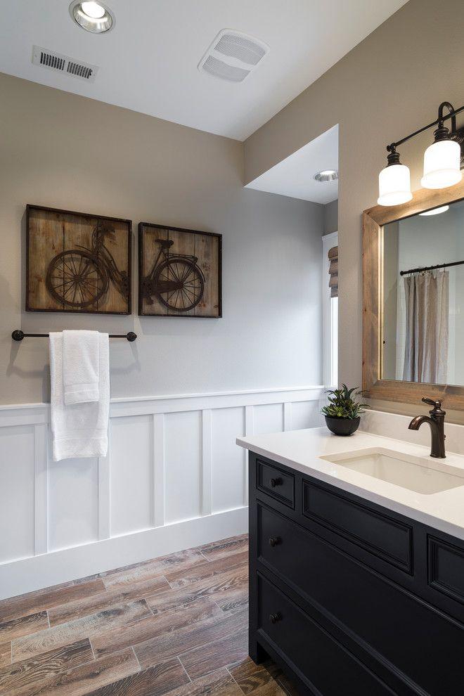 Wall panels bathroom powder room transitional with framed art wood floor towel bar
