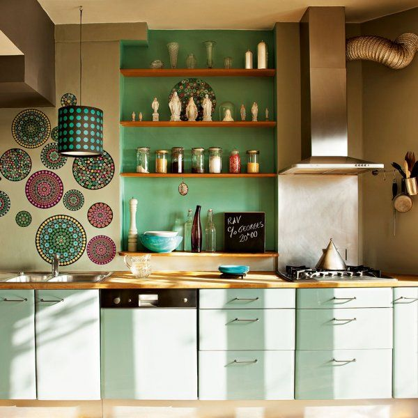 Cute boho kitchen. Love the painted wall art, mint palette and industrial  finishes.