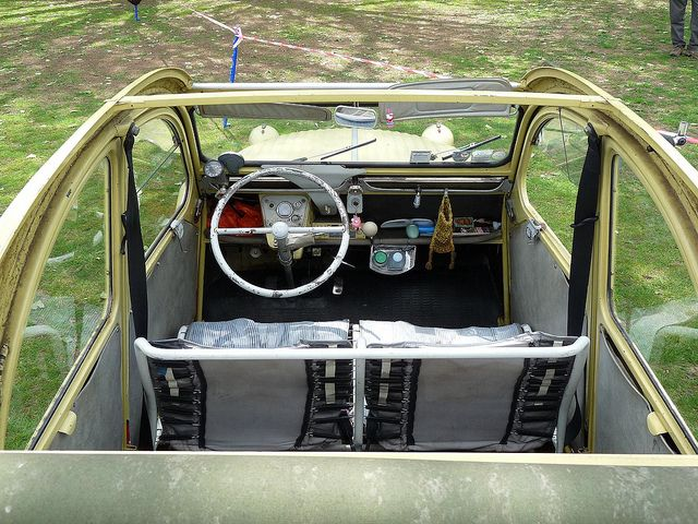 Citroen 2cv interior. Early model has a sliding leather canopy which could be withdrawn to expose almost the entirety of the car and allow for large loads.