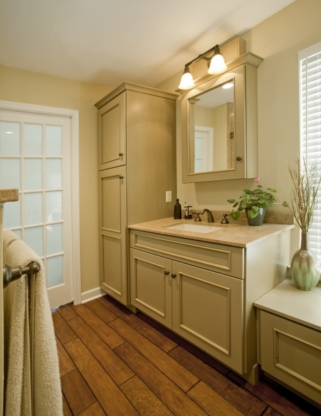 A linen cabinet maximizes storage within the master bath for Master bathroom pocket door