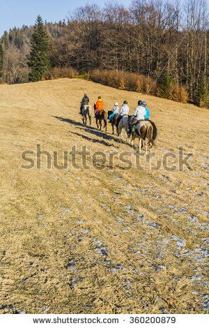 Wierchomla Mala, Poland - January 02, 2016: Group of riders on a trip across the clearing in the forest.  - stock photo