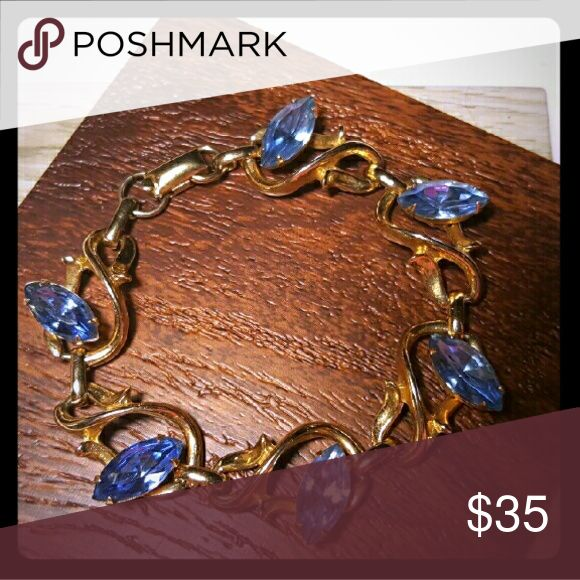 Beautiful VTG Coro Bracelet Gorgous blue saphire gemstones on a goldtone bracelet. Signed Coro. Vintage Jewelry Bracelets