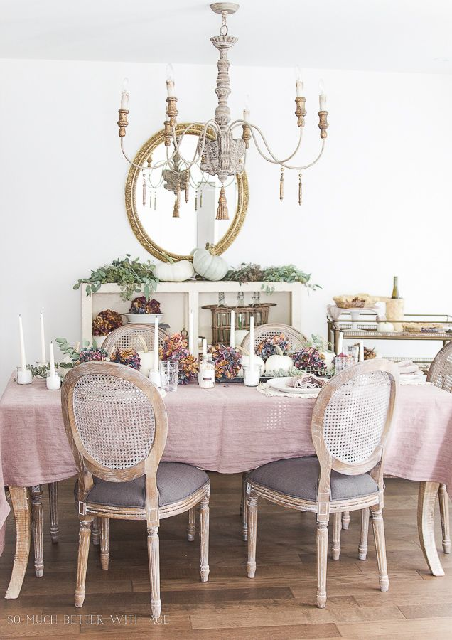 This French country dining is ready for fall! Instead of the typical orange fall colors, purples and greens were used with white pumpkins. Gorgeous!
