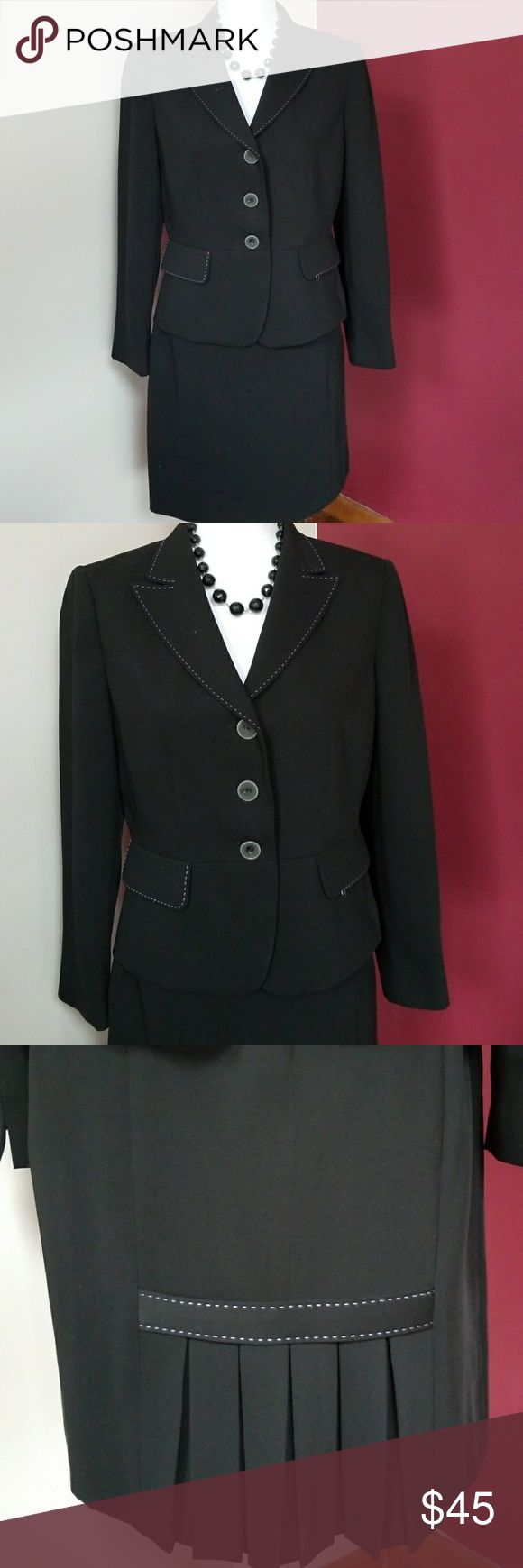 Tahari Two-Piece Suit 💜Two piece lined Tahari suit. Worn just a few times for interviews. There are a few stains om the liner, but no stains or marks on the outside fabric. Black with periwinkle stitching. Jacket has three buttons and faux front pockets. Skirt has flirty pleated back! Very beautiful suit! Size 10  Petite, Poly/Acetate 💜 Tahari Skirts Skirt Sets