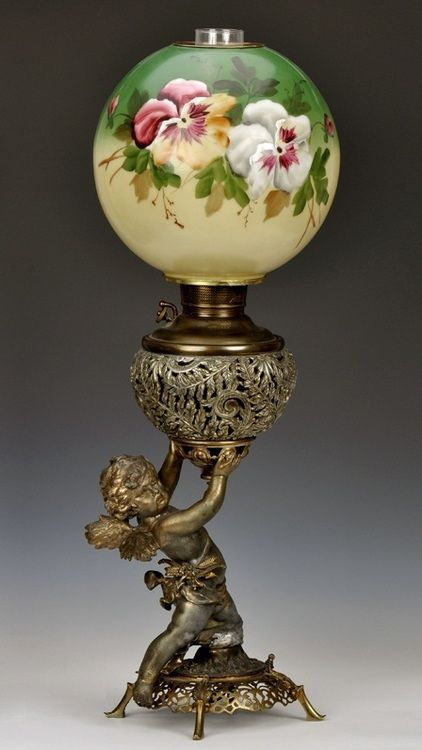 Victorian cast metal parlor oil lamp with cherub base, made by Juno Lamp Co.