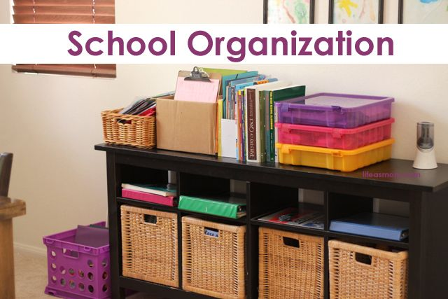 Organize school stuff with clipboards, cubbies, and a designated shelf for library books.