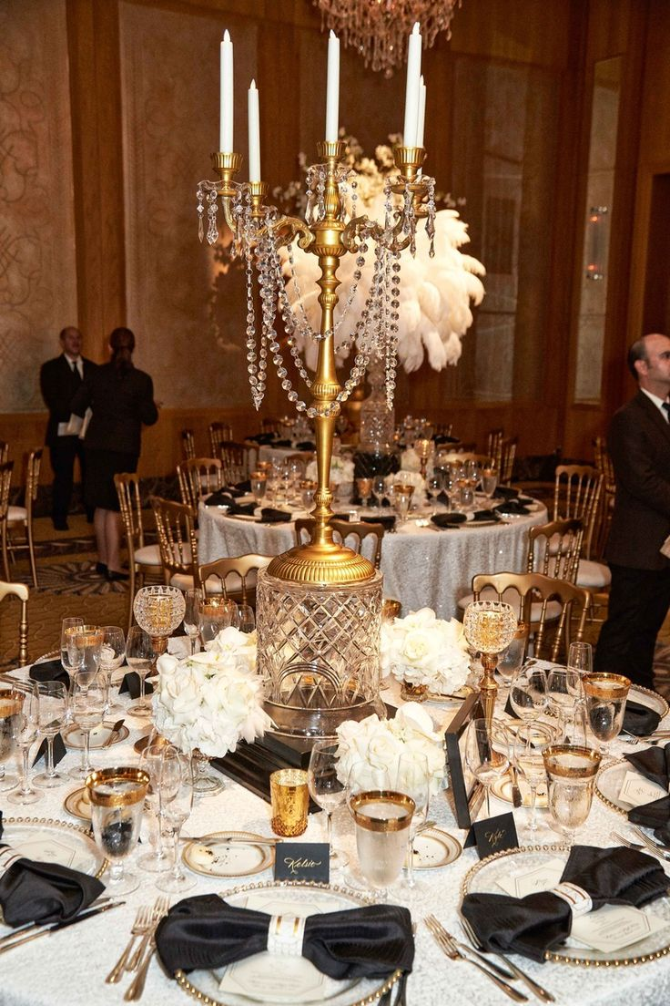 Gold & Crystal Candelabra Centerpiece | Photo: KingenSmith. View More:  http://www.insideweddings.com/weddings/elegant-vintage-inspired-destination-wedding-in-chicago/920/