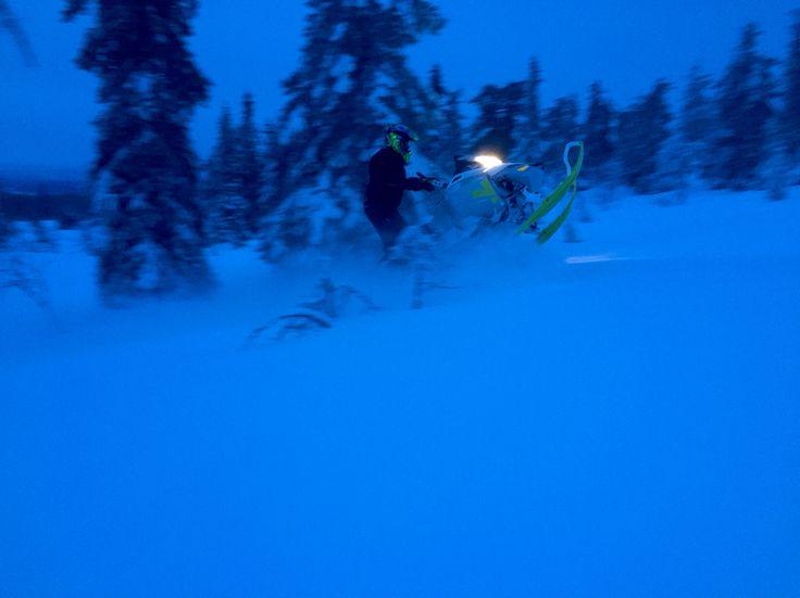 Freeriding snowmobile pow pow weather