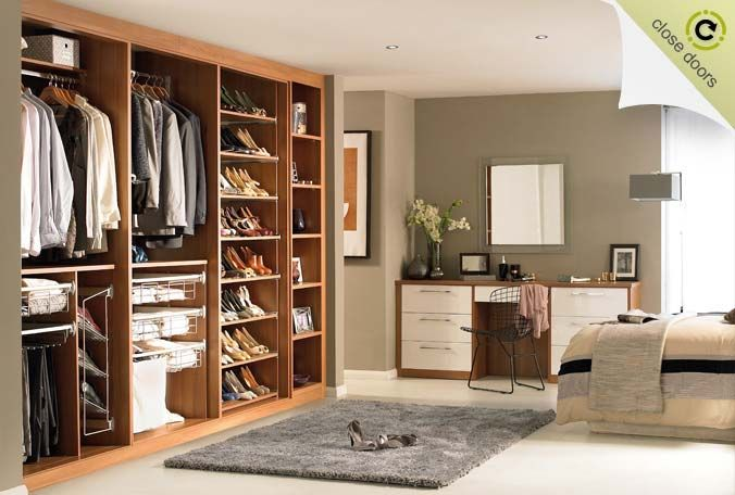 white and wood fitted wardrobe open doors