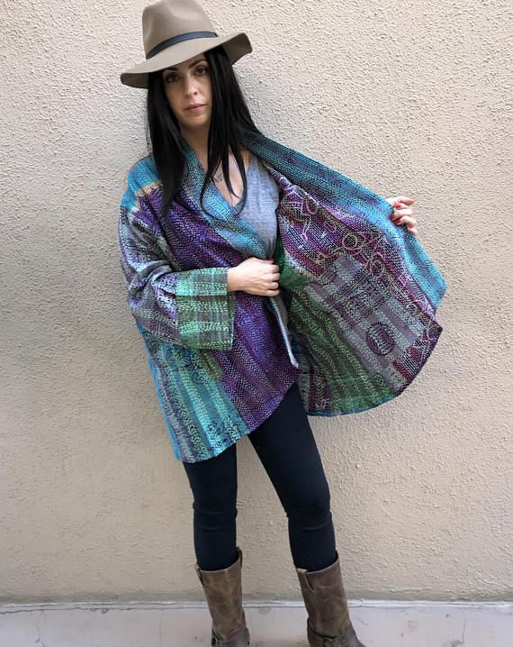 This is silk sari fabric made into kantha shawls and then the coat is made from the scarves. It is a Kimono style, exactly the same measurements as my cotton kantha jackets. This is one size and will fit anyone from a size 6 up to size 18 Pockets on both sides. In the photos you can see the reverse side. Like having 2 jackets for th e price of one. This is a one size jacket that easily fits a plus size woman ( up to 2x) The pictures show it reversed to each side. There are pockets on each…