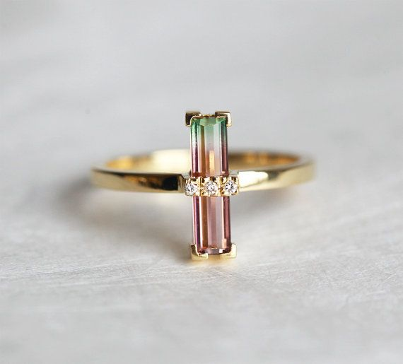 One of a kind, beautiful handmade Diamond and bi-colour Tourmaline ring.  Product details Gemstone: Watermelon tourmaline 11 x 3mm Quality: VS clarity
