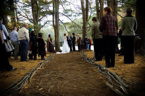 Wedding aisle outlined by branches. Maybe a petal aisle, or outline it with some flowers?