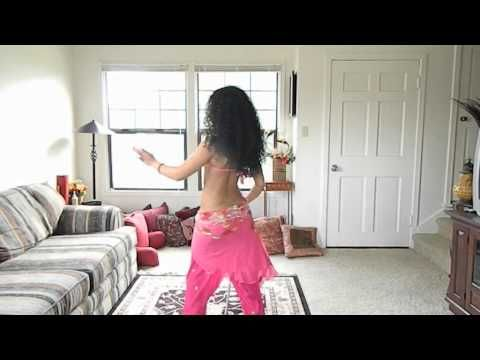 Saidi cane dance: walking hip kicks around the cane ~ Free belly dance classes online