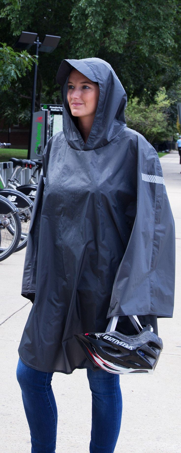 This Made in the USA rain cape features reflective details, a brimmed hood, and thumb loops for dry hiking, biking, or walking.