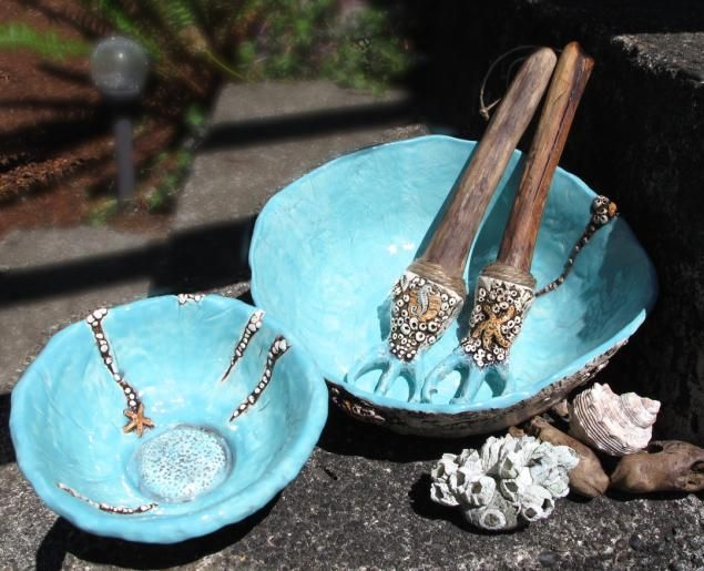Salzano's Cottage Beach Style Entertaining! Neptune Salad Bowls and forks. Ceramic spoons, ladles with driftwood handles.  All in barnacle, pebble beach, and stream themes!