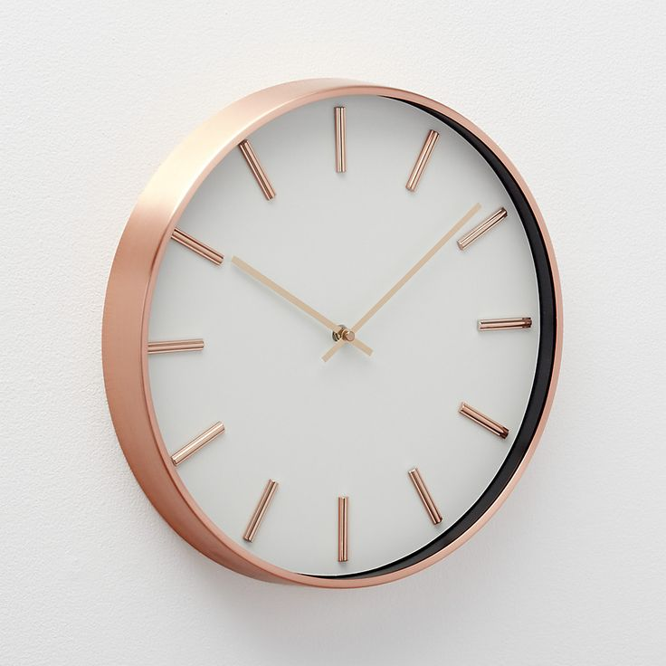 Shop Copper Wall Clock. With its warmth and metallic shine, copper keeps this classic, modern wall clock current. Ringed in a slim metal frame, the clock's white face is simply marked by rods that in for numerals and is swept by slender hands.