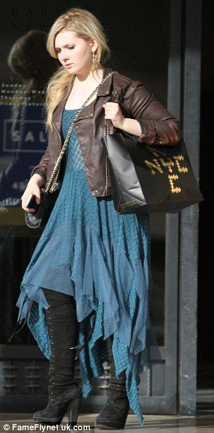 Boho chick: Abigail went for flowing dresses and handkerchief hemlines for her shopping ex...