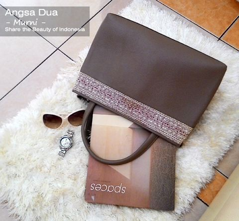 Angsa Dua leather handbag with touched of songket minang.   made in Indonesia