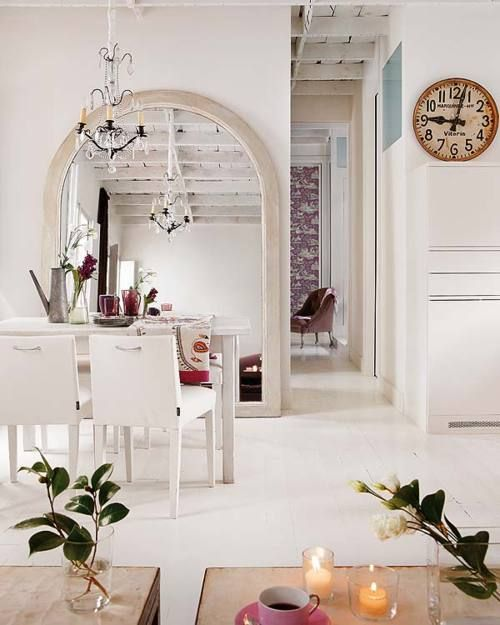 Huge arched mirror stands by the corridor and amps up the architecture of this place.