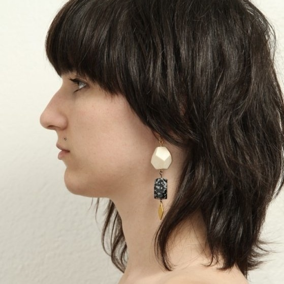 I like the bangs and the back so much. I would want the pieces around my face to be longer.