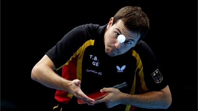 Timo Boll of Germany competes against Leung Chu Yan of Hong Kong, China during the Men's Team Table Tennis bronze medal match on Day 12 of the London 2012 Olympic Games at ExCeL