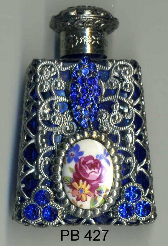 HAND MADE in The CZECH REPUBLIC, AUTHENTIC BOHEMIA GLASS Miniature filigree perfume bottles first appeared in Czechoslovakia. They were most popular from 1910 to 1950, during the Art Deco period. A great collectors item, as well as a wonderful and unique gift. NEW ITEM / GLASS WAND