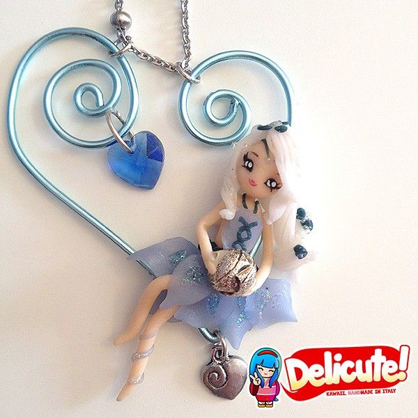 Sweet Wirabola fairy hanged on an artistic wire heart shaped charm. These jewels are completely handmade, 100% Made in Italy with high quality materials. The heart pendant in artistic wire is made of anodized aluminum, modeled by hand.  Find it on www.Delicute.com
