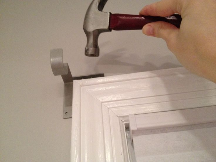 how to put up a curtain pole without a drill