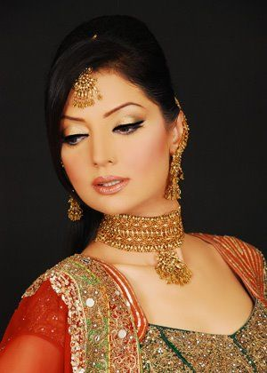 A beautiful light gold makeup look to a red and green outfit.  Make-up: Amina.Z Salon Model: Natasha Hussain Designer: HSY