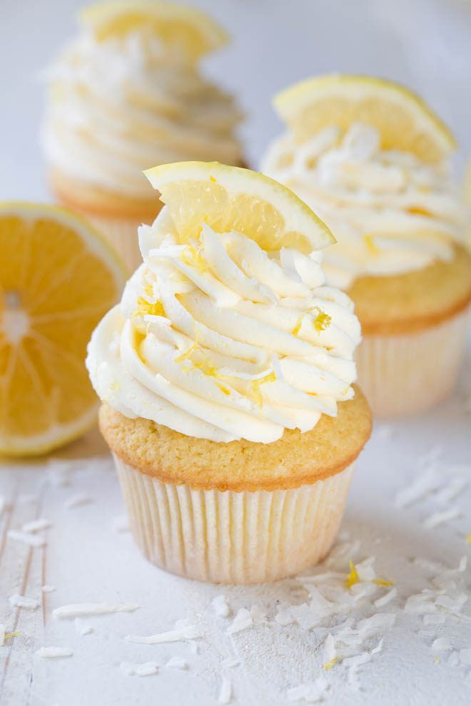 Lemon Coconut Cupcakes with Vanilla Buttercream Frosting are a delectable treat packed with the freshest lemon flavor! Bake a dozen to share with your friends and family. #meyer #lemon #cupcakes #dessert
