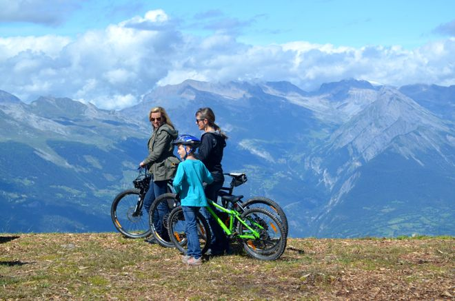 The host of Family Travel with Colleen Kelly cycling around the Swiss Alps. Find out her other latest adventures in our interview http://www.suitcasesandstrollers.com/interviews/view/family-travel-tv-host-colleen-kelly?l=all #GoogleUs #suitcasesandstrollers #travel #travelwithkids #familytravel #familyholidays #familyvacations #Switzerland