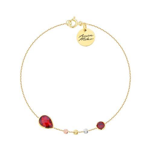 Delikatna złota bransoletka z czerwonymi kamieniami.  Dodatkowo trzy złote ozdobniki w różnych kolorach.  Po prostu piękna !  Doskonała na prezent.  Całość złoto 14K próba 585