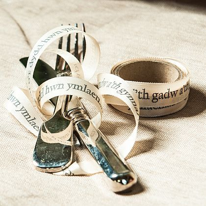 Wedding Vows Ribbon Ivory gros grain ribbon printed with part of the wedding vows in Welsh - to have and to hold from this day forward (i'th gadw a'th gynnal o'r dydd hwn ymlaen). Can be used to tie around flowers, presents, napkins, cake board, or any other item on the big day.