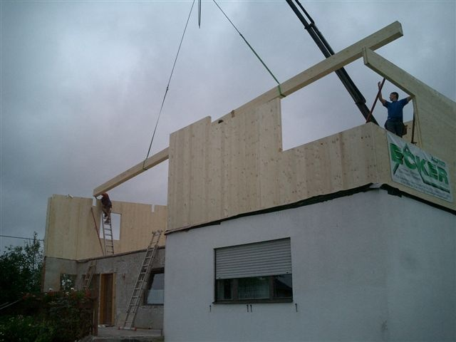 CLT walls and roof superstructure constructed in two days for Osterwasser House…