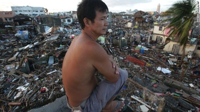 Typhoon Haiyan  A man looks over the devastation from his damaged home in Tacloban on November 17.