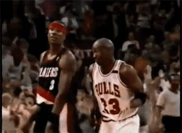 Chicago Bulls guard Michael Jordan shrugs and looks around to the crowd during Game 2 of the 1992 NBA Finals.