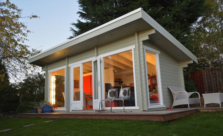 Another lovely shot of the Laggan garden office, this time lit up from the inside as the sun sets - the shadows from the mature trees help highlight the interior colour scheme: http://www.gardenlifelogcabins.co.uk/products/heidi-laggan/product-details.php
