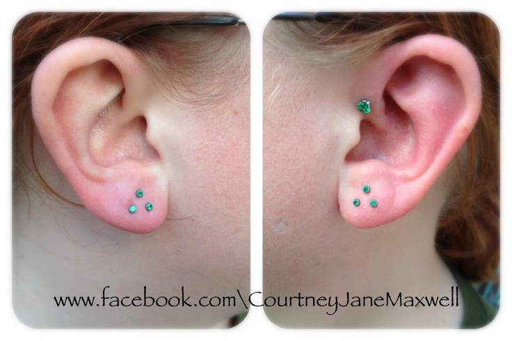 Healed 18g triple lobe piercings with 2mm bezel emerald cz's and matching 4mm prong emerald cz in the forward helix. All jewelry by Neometal