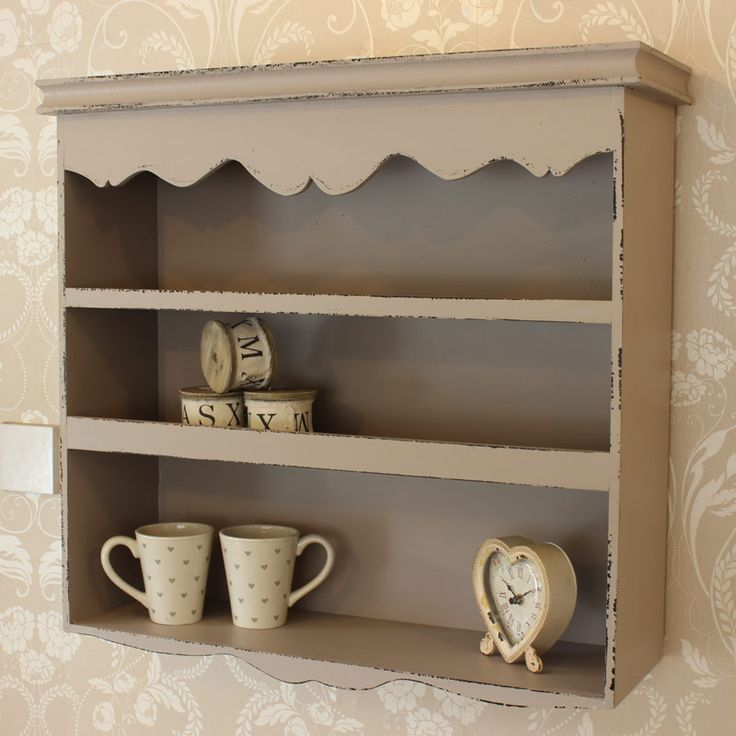 Grey Scalloped Wall Shelf Unit Made from wood with a grey/beige painted finish Beautiful scalloped detailing with a distressed finish to the edging Wall mountable - comes with four hooks to the back for easy hanging Perfect for a bathroom for holding toiletries and trinkets http://www.melodymaison.co.uk/grey-scalloped-wall-shelf-unit.html £94.95