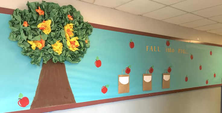 My 1st PTO bulletin board!  Super simple...crumpled up butcher paper for leaves and the cute little kraft gift bags adds to the board I think!  Used my Silhouette Cameo to cut the apples & letters.