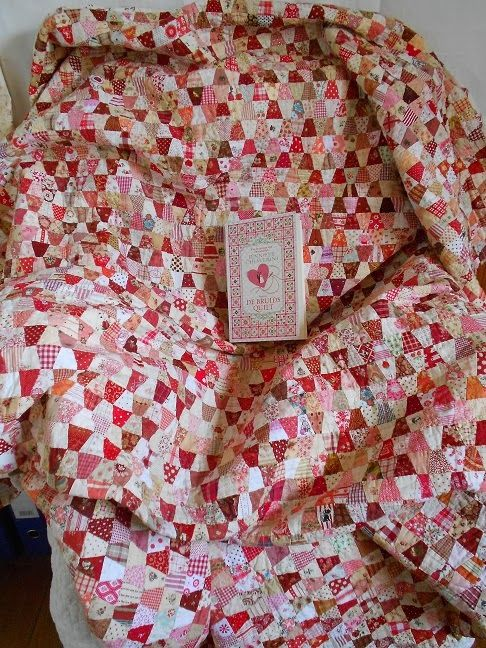 Supergoof Quilts - this is the first quilt of hers that I saw - tiny red & white tumblers - and I've been hooked ever since