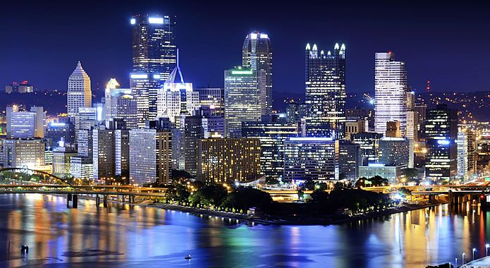 A Colorful Picture Of The Great City Of Philadelphia Shining Against The Beautiful Night Sky