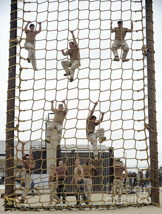 Coronado, California, July 8, 2010 - Sailors navigate the rope climb portion of the obstacle course at the Naval Special Warfare Center in Coronado, California. The Sailors navigated the obstacle course as part of physical training.