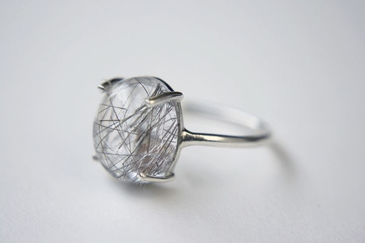 Tourmalinated Quartz Cabochon Ring in sterling silver - sterling silver quartz ring - tourmalinated quartz ring - rutilated quartz ring by TheBeaLine on Etsy https://www.etsy.com/listing/261379856/tourmalinated-quartz-cabochon-ring-in