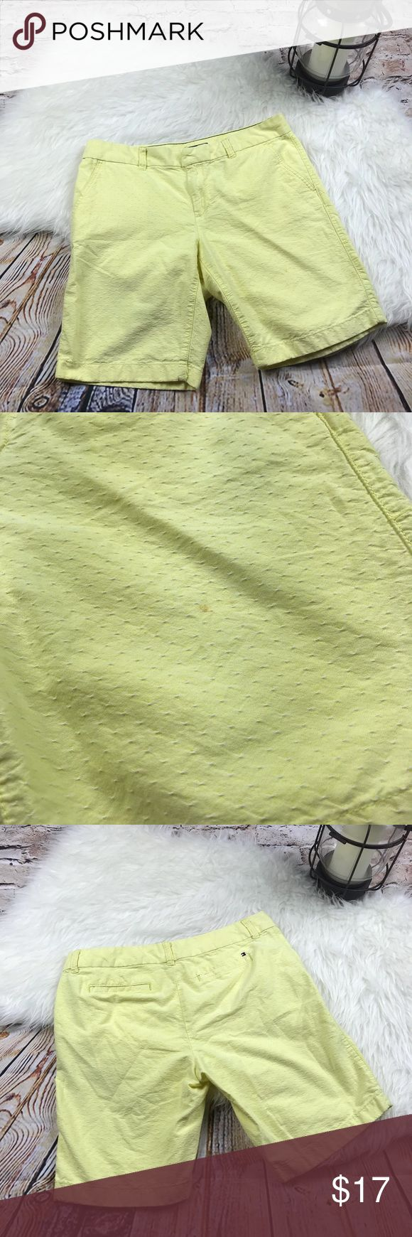 """Tommy Hilfiger womens yellow Bermuda shorts In good condition with only one flaw with is a very small stain on the front shown in the picture above. Otherwise no visible flaws. A light yellow color pair of shorts with white designs.   Size-8 Waist about-16"""" Rise about-9"""" Inseem about-9""""  C19 Tommy Hilfiger Shorts Bermudas"""