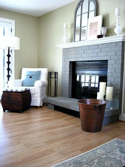 out with the brick in with the gray, concrete masonry, fireplaces mantels, home decor, painting, I love mixing warm and cool neutrals so I kept our walls tan and have chestnut blue and white accents nearby