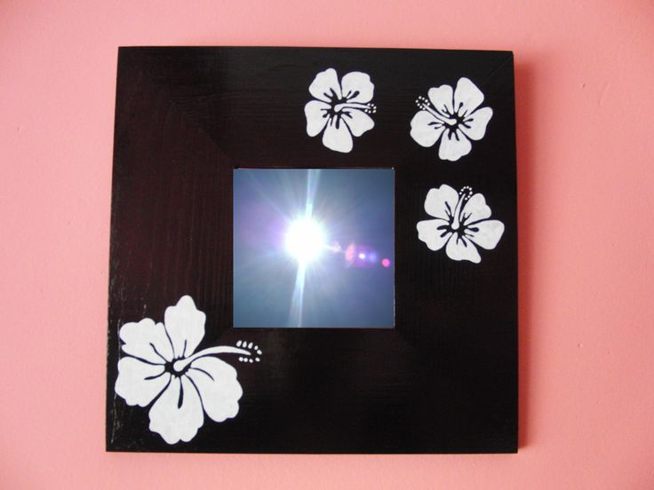 Black mirror with hibiscus.