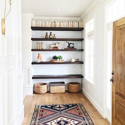 Hallway with open shelving, woven baskets, and printed bohemian multicolored rug