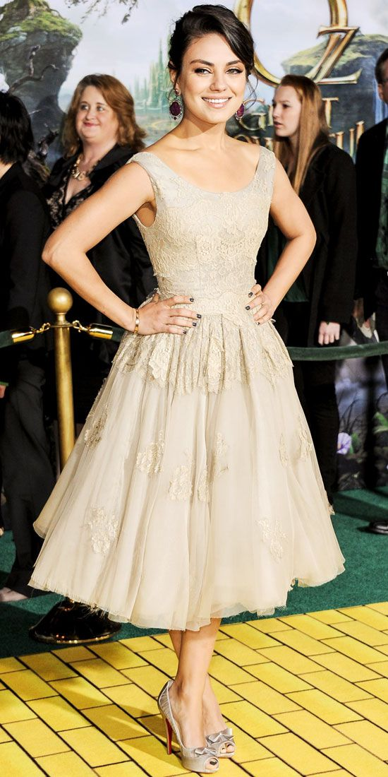 """Mila Kunis in a Dolce & Gabbana dress, Christian Louboutin heels, and Sutra statement earrings at the Hollywood premiere of """"Oz: The Great and Powerful"""", February 14, 2013"""