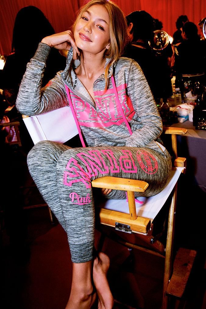 Gigi Hadid wearing Victoria's Secret Pink Perfect Half-Zip Hoodie and Victoria's Secret Pink Skinny Collegiate Pants